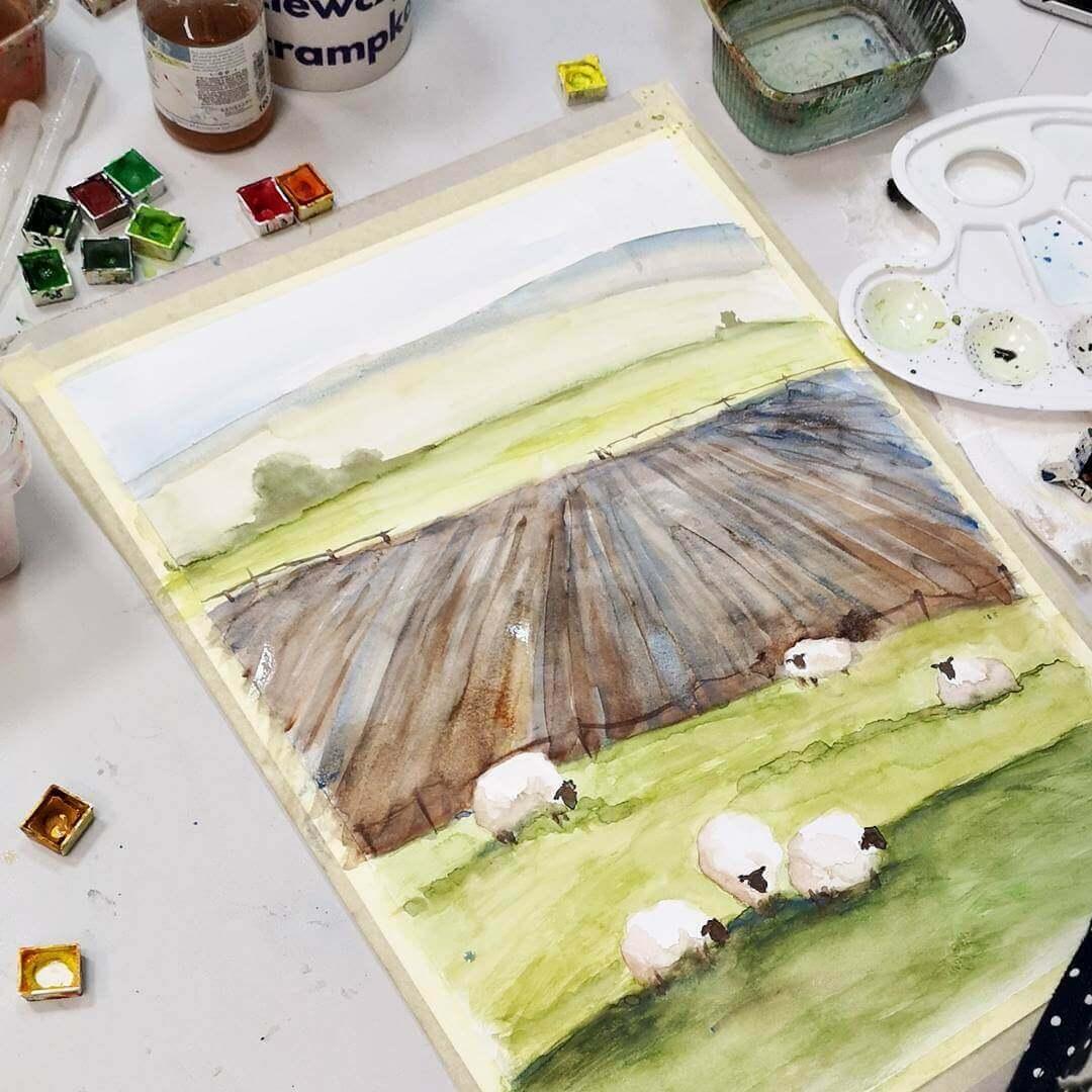 Malujemy pole z owcami akwarelą.